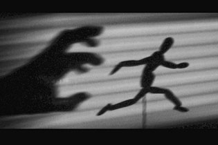 shadow hand chasing shadow wooden puppet